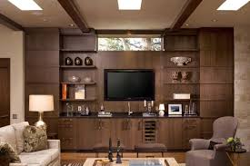 wooden cabinets for living room large brown wooden cabinet and shelving unit also black led tv on