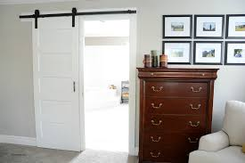 Barn Door Interior White Stained Wood Sliding Barn Door Hanging On Black Rod Next To