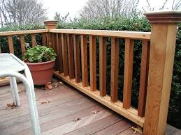 wooden deck railing in the backyard ways to covering a