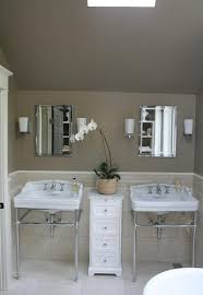 bathrooms white porcelain sinks polished chrome faucets sconces