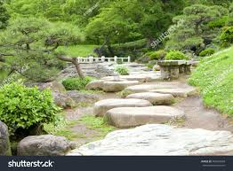 two benches green plants flowers stone stock photo 484210699