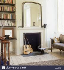 Big Wall Mirrors by Guitars In A Fireplace Below Large Wall Mirror In Hall Living Room