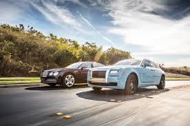 roll royce ghost 2014 rolls royce ghost vs 2014 bentley flying spur comparison