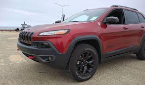 2016 jeep cherokee sport red storming the beach with the 2016 jeep cherokee trailhawk the