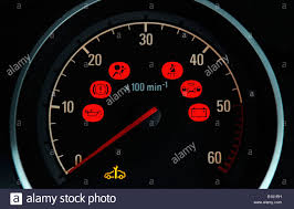 car dashboard a british car dashboard rev counter dial with various red warning