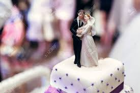 wedding cake figurines and groom on wedding cake figurines on cake top with purple