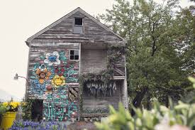 Flowers In Detroit - an abandoned house in detroit blooms with aromatic plants
