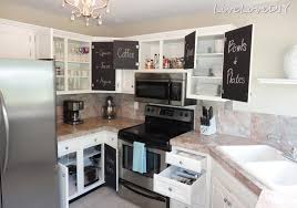 in the galley kitchen are blue grey cabinets butcher block