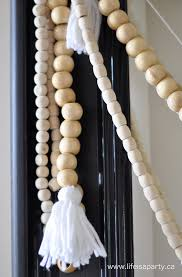 how to make home decor crafts how to make wood bead garland with yarn tassels easy diy for