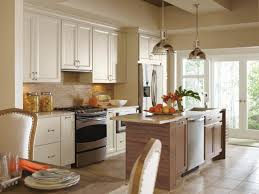 white kitchen cabinets with medium wood island dynasty cayhill