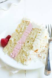 coconut cake with marshmallow frosting and raspberry buttercream
