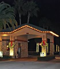 entry roofline bushes walkway and trees outdoor christmas