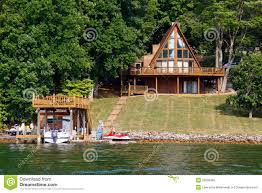 a frame house on water with boats royalty free stock photo image