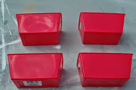 red plastic storage boxes