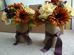 centerpieces kerr bottles wrapped in burlap and a purple ribbon