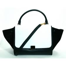 an online boutique for new and pre owned luxury designer handbags