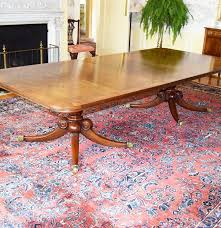 a custom wood and hogan inc double pedestal mahogany dining table