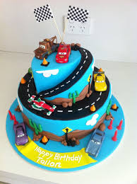 cars birthday cake cars 2 birthday cake 2 tier chocolate mud covered in ganache and