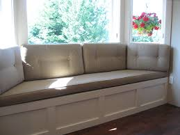 gray velvet seat cushion pad over l shaped white beadboard window