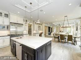 carrara marble kitchen island kitchen with u shaped pendant light in bethesda md zillow