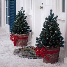 christmas tree with white lights and red bows 38 outdoor christmas trees that wow digsdigs