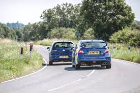 vw golf r vs subaru impreza wrx sti twin test review 2015 by car