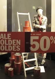 label sale solden soldes paint buckets window display at we