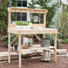 diy potting bench with tool hooks and storage for backyard garden