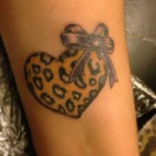 cheetah print bow tattoo