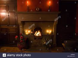 a blazing log fire and candles in the dining room of a georgian