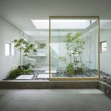 interior contemporary home inside viewed through glass wall