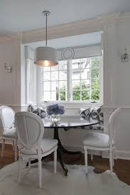 25 Space Savvy Banquettes With Chic Monochromatic Dining Space With Built In Beadboard Banquette