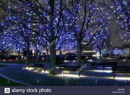 night shot of gabriel u0027s wharf southbank london with blue lights