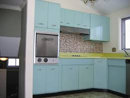 traditional blue retro cabinets and mosaic tile backsplash inside