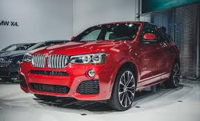 bmw x4 reviews bmw x4 price photos and specs car and driver