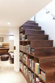 nice bookshelves under the wooden staircase design with bright