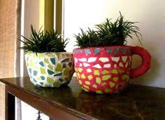 these giant teacup planters looked cute stacked together and were