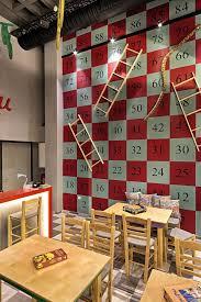 gallery of alaloum board game café triopton architects 12
