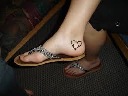 black ink coolest heart ankle heel tattoo design for cool women