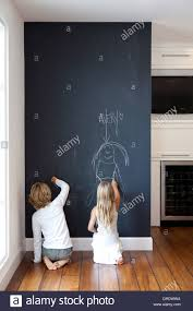 chalk board wall layla at the lettered cottage used chalkboard kids writing on chalkboard wall stock image