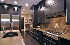 how do you stain kitchen cabinets we ve seen many gorgeous black painted and stained kitchen cabinets