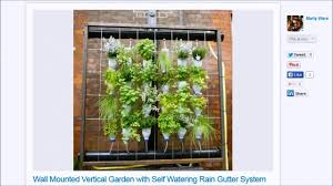 wall mounted vertical bottle garden with self watering rain gutter