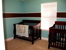 young boy girls bedroom design with pink wall paint color and baby