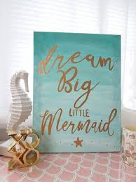 hand lettered mermaid nursery wall decor in aqua ombre and gold