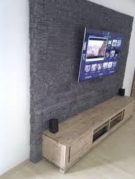 steinwand wohnzimmer tv die besten 25 tv wand ideen auf tv wand schwarz tv