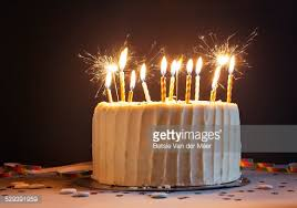 birthday cake candles birthday cake with candles and sparklers stock photo getty images