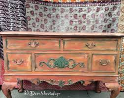 we specialize in vintage goods and hand painted by daretobevintage