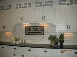 brick tile backsplash kitchen faux brick wallboard from lowes painted and glued on then add trim