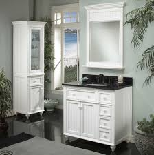 white quartz topped vanity with dark wooden drawers and doors