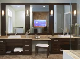 bahtroom small wall lamp on dark mirror edge installed vanity